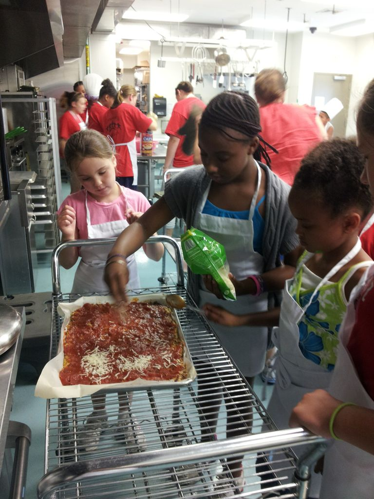 Making pizza with a zucchini crust at cooking camp
