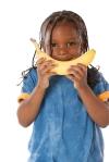 child with banana